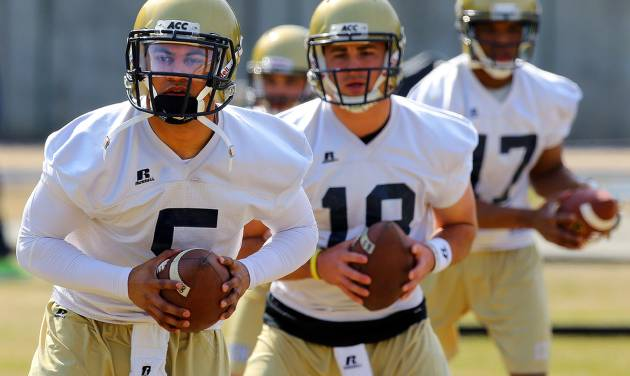 Georgia Tech quarterbacks, from left,  Justin Thomas, the probable starter, Tim Byely, and Ty Griffin run through drills on the first day of spring football practice at Georgia Tech on Monday, March 24, 2014, in Atlanta.  (AP Photo/Atlanta Journal-Constitution, Curtis Compton)  MARIETTA DAILY OUT; GWINNETT DAILY POST OUT; LOCAL TV OUT; WXIA-TV OUT; WGCL-TV OUT