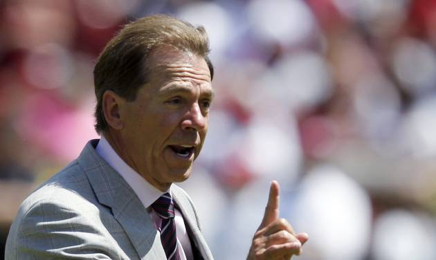 Alabama coach Nick Saban signals a fourth and 1 during Alabama's A-Day NCAA college football spring game Saturday, April 19, 2014, in Tuscaloosa, Ala. (AP Photo/Butch Dill)