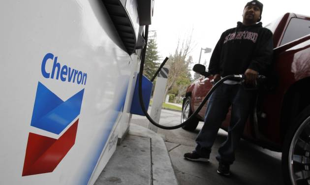 FILE - In this Jan. 28, 2011 file photo, a customer pumps gas at a Chevron gas station in Mountain View, Calif. Chevron Corp. reports quarterly earnings on Friday, May 2, 2014. (AP Photo/Paul Sakuma, File)