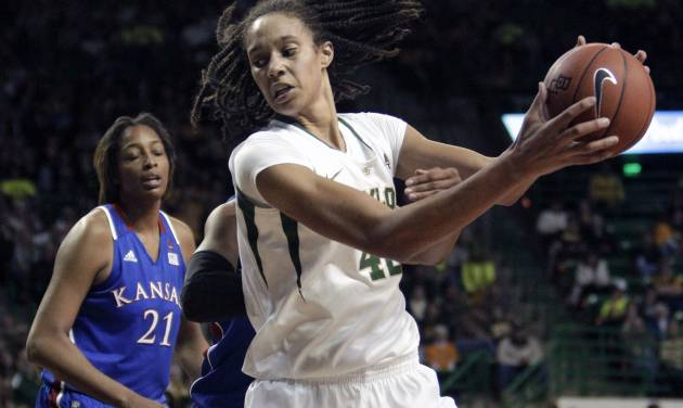 Baylor 's Brittney Griner (42) moves the ball against Kansas' Aishah Sutherland, rear, as Carolyn Davis (21) looks on in the second half of an NCAA women's college basketball game Saturday, Jan. 28, 2012, in Waco, Texas. Griner had seven rebounds, five blocks and 28-points in the 74-46 Baylor win. (AP Photo/Tony Gutierrez)