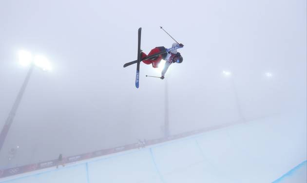 David Wise of the United States  jumps during a freestyle skiing training session in the halfpipe at the Rosa Khutor Extreme Park, at the 2014 Winter Olympics, Monday, Feb. 17, 2014, in Krasnaya Polyana, Russia. (AP Photo/Sergei Grits)