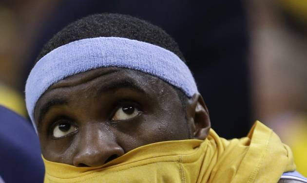 Denver Nuggets' Ty Lawson looks at the scoreboard during the second half of Game 3 in a first-round NBA basketball playoff series against the Golden State Warriors on Friday, April 26, 2013, in Oakland, Calif. (AP Photo/Ben Margot)