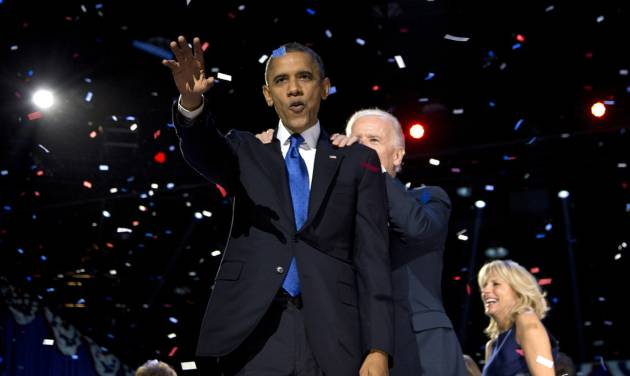 President Barack Obama and Vice President Joe Biden celebrate on stage at the election night party at McCormick Place, Wednesday, Nov. 7, 2012, in Chicago. Obama defeated Republican challenger former Massachusetts Gov. Mitt Romney. (AP Photo/Carolyn Kaster)