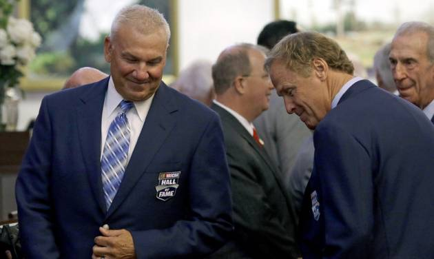 NASCAR racing legends Dale Jarrett, left, and Rusty Wallace are seated on the House floor during the opening session of the General Assembly in Raleigh, N.C., Wednesday, May 14, 2014 where lawmakers honored the NASCAR Hall of Fame inductees. (AP Photo)