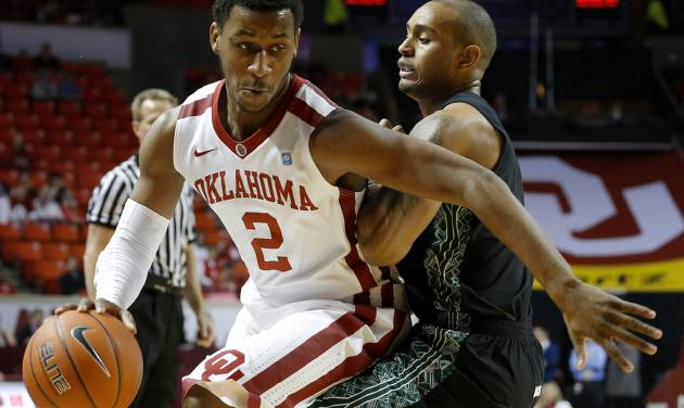 Oklahoma's Steven Pledger (2) goes past Ohio's Walter Offutt (3) during a NCAA college basketball game between the University of Oklahoma (OU) and Ohio at the Lloyd Noble Center in Norman, Saturday, Dec. 29, 2012. Photo by Bryan Terry, The Oklahoman