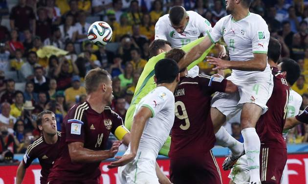 Algeria's Islam Slimani heads the ball to score during the group H World Cup soccer match between Algeria and Russia at the Arena da Baixada in Curitiba, Brazil, Thursday, June 26, 2014. (AP Photo/Jon Super)