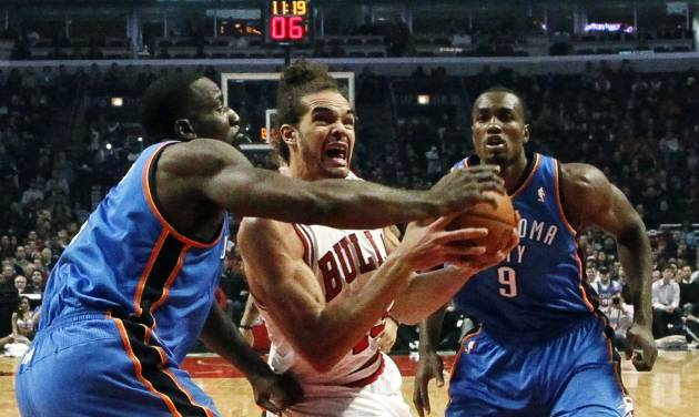 Chicago Bulls center Joakim Noah (13) drives the lane between Oklahoma City Thunder center Kendrick Perkins, left, and Serge Ibaka (9) during the first half of an NBA basketball game, Thursday, Nov. 8, 2012, in Chicago. (AP Photo/Charles Rex Arbogast) ORG XMIT: CXA106