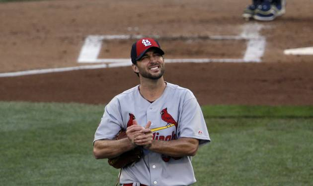 National League starting pitcher Adam Wainwright returns to the mound after giving up a home run to Miguel Cabrera, of the Detroit Tigers during the first inning of the MLB All-Star baseball game, Tuesday, July 15, 2014, in Minneapolis. (AP Photo/Paul Sancya)