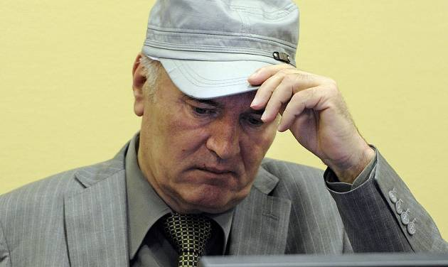 FILE - In this June 3, 2011 file photo, former Bosnian Serb Gen. Ratko Mladic removes his hat in the court room during his initial appearance at the U.N.'s Yugoslav war crimes tribunal in The Hague, Netherlands. The chief prosecutor of the Yugoslav war crimes tribunal said Wednesday, Oct. 19, 2011 that he is considering trimming the indictment against former Bosnian Serb military chief Gen. Ratko Mladic to speed up the case. (AP Photo/Martin Meissner, Pool-File)