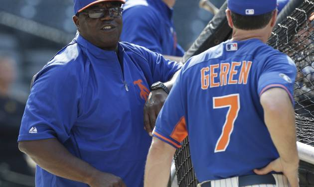 New York Mets batting coach Lamar Johnson speaks to Bob Geren, right, during batting practice before a baseball game against the Pittsburgh Pirates Tuesday, May 27, 2014, in New York.  (AP Photo/Frank Franklin II_