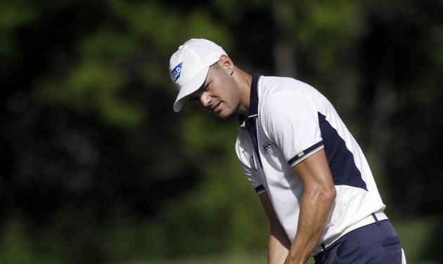 Martin Kaymer, of Germany, makes a birdie putt on the eighth hole during the first round of The Players championship golf tournament at TPC Sawgrass, Thursday, May 8, 2014, in Ponte Vedra Beach, Fla. Kaymer leads the tournament at 9-under par after the first round. (AP Photo/Gerald Herbert)