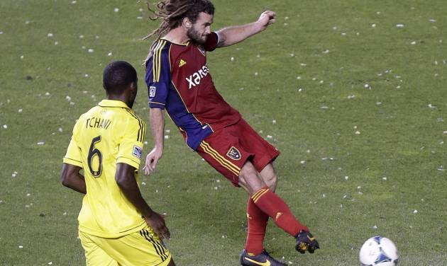 Real Salt Lake's Kyle Beckerman, right, scores as Columbus Crew's Tony Tchani (6) looks on in the second half of an MLS soccer game, Saturday, Aug. 24, 2013, in Sandy, Utah. Real Salt Lake defeated the Columbus Crew 4-0. (AP Photo/Rick Bowmer)