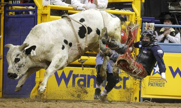 LJ Jenkins of Porum is thrown from Mr. Slim during bull riding competition at the tenth and final go-round of the National Final Rodeo on Saturday in Las Vegas.  AP Photo