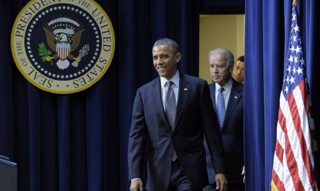 President Barack Obama, followed by Vice President  Joe Biden, arrives in the South Court Auditorium at the White House in Washington, Wednesday, Jan. 16, 2013, to talk about proposals to reduce gun violence.  (AP Photo/Susan Walsh)