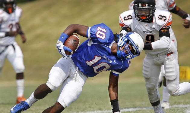 HIGH SCHOOL FOOTBALL: Millwood receiver Alfonzo McMillian is taken down from behind by Douglass' Isiah Shaputis after a gain on a pass reception  during the annual Soul Bowl football game  between the  Douglass Trojans and  the Millwood Falcons at Leodies Robinson Field in Oklahoma City on  Saturday, Sep. 14, 2013. Millwood defeated Douglass, 31-12.    Photo  by Jim Beckel, The Oklahoman.