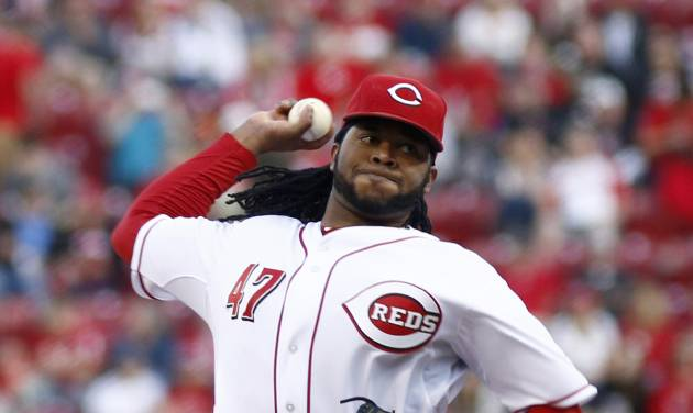 Cincinnati Reds starting pitcher Johnny Cueto throws against the Milwaukee Brewers during the first inning of a baseball game, Saturday, May 3, 2014, in Cincinnati. (AP Photo/David Kohl)