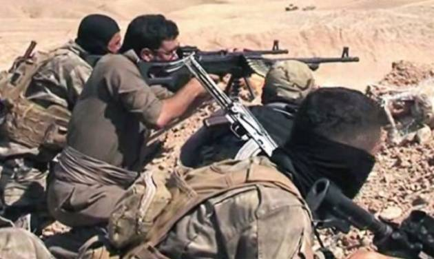 In this Tuesday, June 17, 2014 image taken from video obtained from British Broadcaster Sky, which has been authenticated based on its contents and other AP reporting, Kurdish soliders aim their weapons towards positions held by fighters of the Islamic State of Iraq and the Levant near Jalula, Iraq. Kurdish security forces are engaged in gun battles with Sunni militants in the northern Iraqi town of Jalula, according to British Broadcaster Sky. Footage showed Kurdish fighters known as peshmerga using heavy artillery and rockets to attack militant positions on Tuesday. (AP Photo/Sky via AP video)