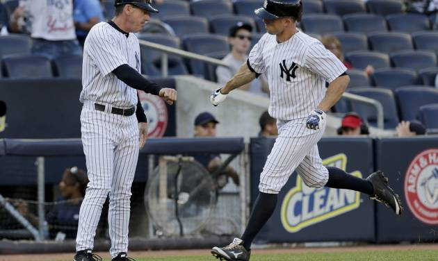 New York Yankees' Brett Gardner (11) is congratulated by third base coach Rob Thompson as he rounds the bases after hitting home run against the Pittsburgh Pirates during the sixth inning of a baseball game, Saturday, May 17, 2014, in New York. (AP Photo/Julie Jacobson)