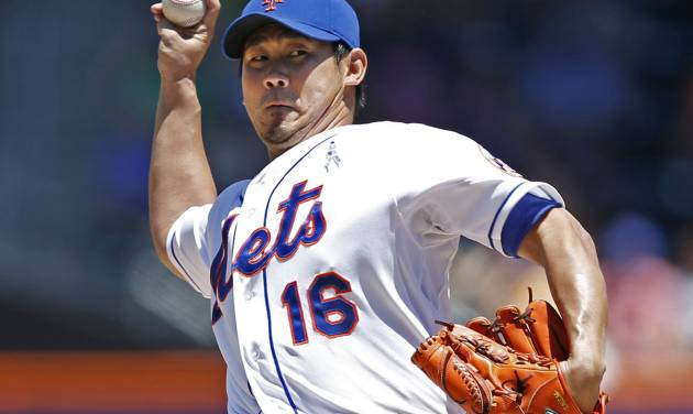 New York Mets' Daisuke Matsuzaka delivers during the first inning of a baseball game against the San Diego Padres in New York, Sunday, June 15, 2014. (AP Photo/Kathy Willens)