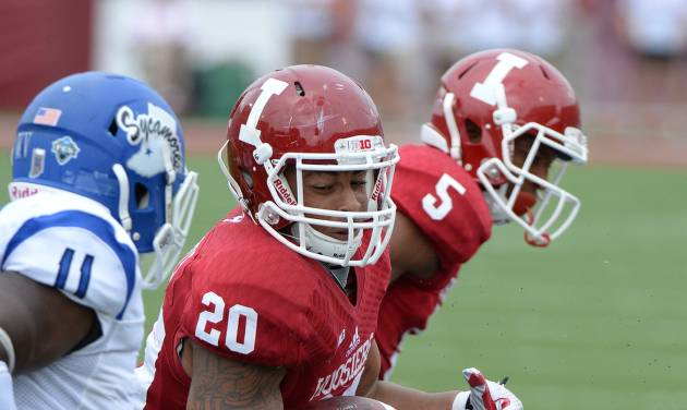 Indiana running back D'Angelo Roberts (20) is tackled by Indiana State's Travis Starks (7) during an NCAA college football game at Memorial Stadium in Bloomington, Ind., Saturday, Aug. 30, 2014. (AP Photo/The Herald-Times, Chris Howell)