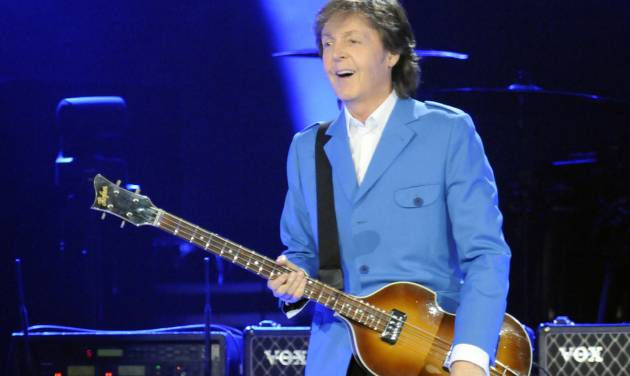 "Sir Paul McCartney performs with his band during the ""Out There"" Tour at the Times Union Center on Saturday, July 5, 2014, in Albany, N.Y. (Photo by Hans Pennink/Invision/AP)"