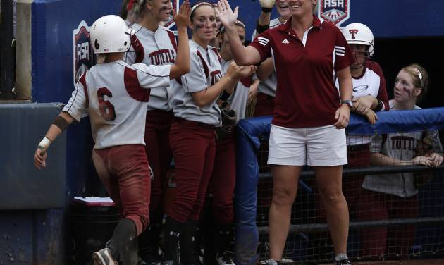 Tuttle's Shelby Carel (6) celebrates with head coach Jenn White after scoring a run during the 4A state softball semifinals game between Oolagah-Talala and Tuttle at ASA Hall of Fame Stadium in Oklahoma City, Okla., Friday, Oct. 12, 2012.  Photo by Garett Fisbeck, The Oklahoman