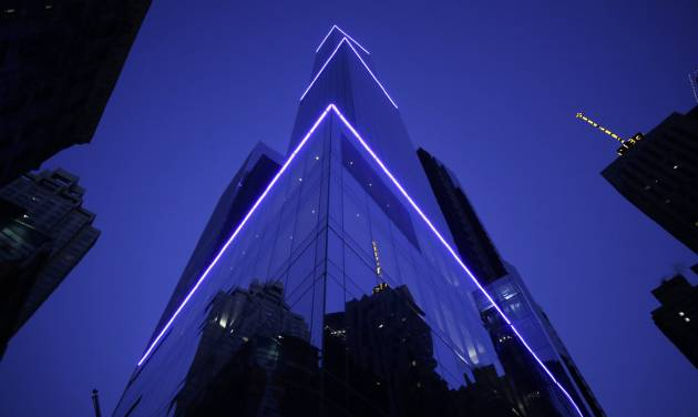 The 68-story Courtyard-Residence Inn Central Park is illuminated early Wednesday, Jan. 8, 2014, in New York. The Council on Tall Buildings and Urban Habitat in Illinois, which compiles lists of tall buildings, is listing the building as the tallest hotel in North America. (AP Photo/Mark Lennihan)
