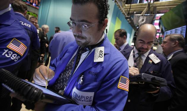 Trader Richard Scardino, left, works on the floor of the New York Stock Exchange Thursday, Oct. 18, 2012. The U.S. stock market headed slightly lower on Thursday, following a leap in claims for unemployment benefits and weak results from American Express. (AP Photo/Richard Drew)