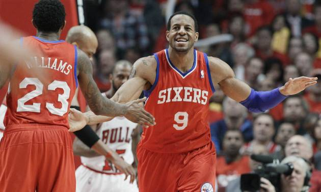 Philadelphia 76ers forward Andre Iguodala (9) smiles as he celebrates with guard Louis Williams (23) after his dunk against the Chicago Bulls during the third quarter of Game 2 in an NBA basketball first-round playoff series, in Chicago on Tuesday, May 1, 2012. (AP Photo/Nam Y. Huh) ORG XMIT: CXA117