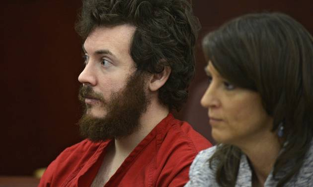 FILE - In this March 12, 2013 file photo, James Holmes, left, and defense attorney Tamara Brady appear in district court in Centennial, Colo. for his arraignment. Prosecutors say they are not are ready to accept an offer from Colorado theater shooting suspect James Holmes to plead guilty in exchange for avoiding the death penalty. In a court filing Thursday, March 28, 2013 prosecutors criticized defense attorneys for publicizing Holmes' offer to plead guilty. (AP Photo/The Denver Post, RJ Sangosti, Pool, File)