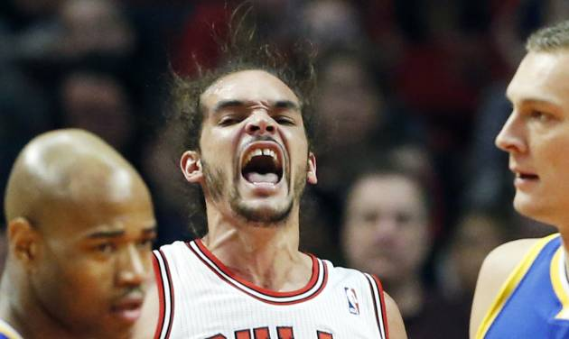 Chicago Bulls center Joakim Noah, center, reacts after Golden State Warriors' player fouled during the first half of an NBA basketball game in Chicago on Friday, Jan. 25, 2013. (AP Photo/Nam Y. Huh)