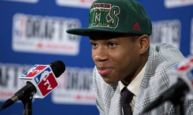Greece's Giannis Antetokounmpo, picked by the Milwaukee Bucks in the first round of the NBA basketball draft, speaks during a news conference Thursday, June 27, 2013, in New York. (AP Photo/Craig Ruttle)