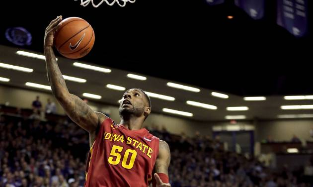 Iowa State's DeAndre Kane (50) gets past Kansas State's Jevon Thomas (5) to put up a shot during the first half of an NCAA college basketball game Saturday, March 1, 2014, in Manhattan, Kan. (AP Photo/Charlie Riedel)