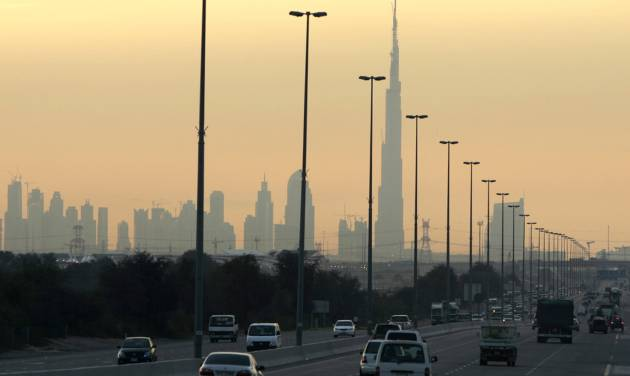 FILE - In this Tuesday, Jan. 20, 2008 file photo, vehicles move towards the skyline of Dubai with the world's tallest building, Burj Khalifa, then under construction in the background. The United Arab Emirates, already home to the world's tallest tower, is now reaching for the stars, with plans to send the first Arab spaceship to Mars in 2021. The energy-rich country on the eastern tip of the Arabian Peninsula announced plans Wednesday, July 16, 2014, to establish a space program to oversee the undertaking. (AP Photo/Kamran Jebreili, File)