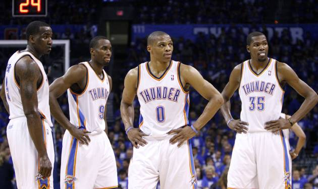 NBA BASKETBALL: Oklahoma City's Kendrick Perkins (5), Serge Ibaka (9, Russell Westbrook (0) and Kevin Durant (35) talk during Game 3 of the Western Conference Finals between the Oklahoma City Thunder and the San Antonio Spurs in the NBA playoffs at the Chesapeake Energy Arena in Oklahoma City, Thursday, May 31, 2012.  Photo by Sarah Phipps, The Oklahoman