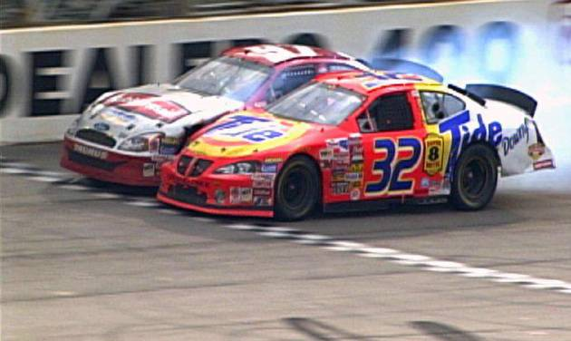 "FILE - In this March 16, 2003 image that was retrieved from the NASCAR scoring camera positioned at the start/finish line, Ricky Craven (32) beats Kurt Busch by .002 seconds to win the Carolina Dodge Dealers 400 auto race at Darlington Raceway in Darlington, S.C. It was 10 years ago that Busch came up an agonizing .002 seconds shy of victory to Ricky Craven at the track ""Too Tough To Tame."" He gets his next chance at a Darlington checkered flag this week at Southern 500.  (AP Photo/NASCAR, File)"