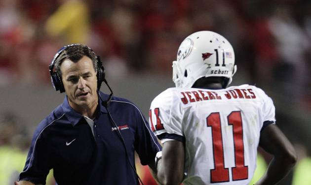 South Alabama coach Joey Jones congratulates Jereme Jones (11) following Jones' touchdown against North Carolina State during the second half of an NCAA college football game in Raleigh, N.C., Saturday, Sept. 15, 2012. North Carolina State won 31-7. (AP Photo/Gerry Broome)