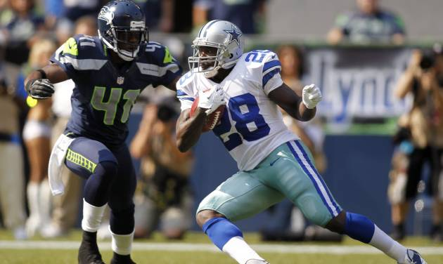 Dallas Cowboys' Felix Jones (28) rushes as Seattle Seahawks' Byron Maxwell defends in the first half of an NFL football game on Sunday, Sept. 16, 2012, in Seattle. (AP Photo/John Froschauer)
