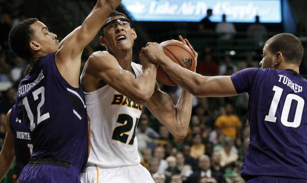 Northwestern's Jared Swopshire (12) and Mike Turner (10) combine to stop a drive to the basket by Baylor's Isaiah Austin (21) in the second half of an NCAA college basketball game Tuesday, Dec. 4, 2012, in Waco, Texas. Northwestern defeated Baylor 74-70. (AP Photo/Tony Gutierrez) ORG XMIT: TXTG111