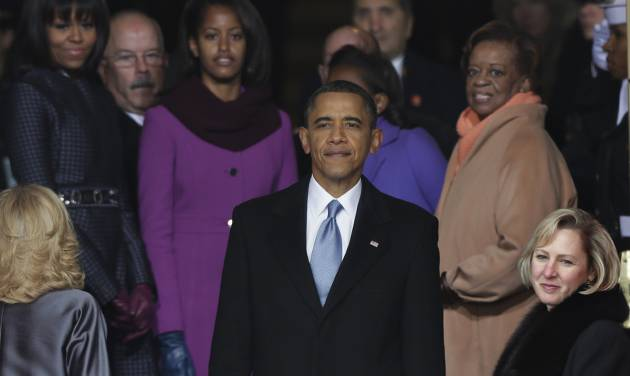 President Barack Obama pauses with his family at the top of the stairs of the U.S. Capitol after at the ceremonial swearing-in during the 57th Presidential Inauguration in Washington, Monday, Jan. 21, 2013. (AP Photo/Pablo Martinez Monsivais)