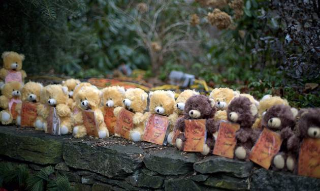 Teddy bears, each representing a victim of the Sandy Hook Elementary School shooting, sit on a wall at a sidewalk memorial, Sunday, Dec. 16, 2012, in Newtown, Conn. A gunman walked into Sandy Hook Elementary School in Newtown Friday and opened fire, killing 26 people, including 20 children. (AP Photo/David Goldman)