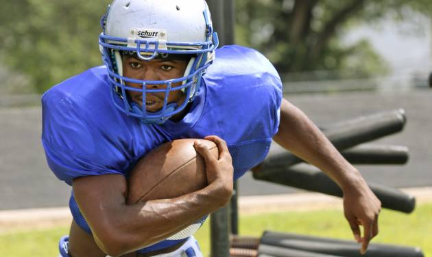 Guthrie High School's Kelyn Hinds runs a drill during practice in Guthrie, Friday  August  15, 2014. Photo By Steve Gooch, The Oklahoman