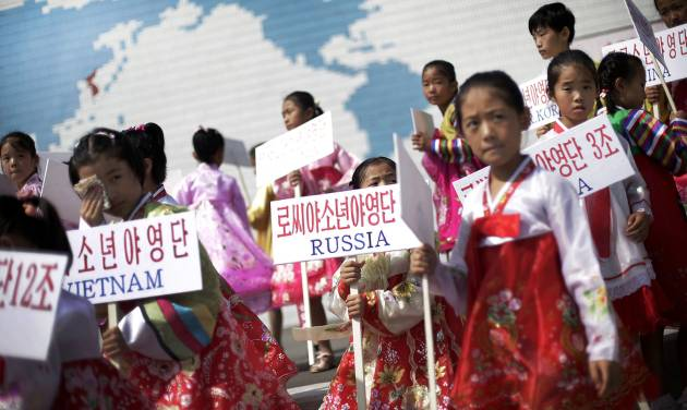 Young North Korean girls hold up signboards with the names of participating countries during an opening ceremony at the Songdowon International Children's Camp, Tuesday, July 29, 2014, in Wonsan, North Korea. The camp, which has been operating for nearly 30 years, was originally intended mainly to deepen relations with friendly countries in the Communist or non-aligned world. But officials say they are willing to accept youth from anywhere - even the United States.  (AP Photo/Wong Maye-E)