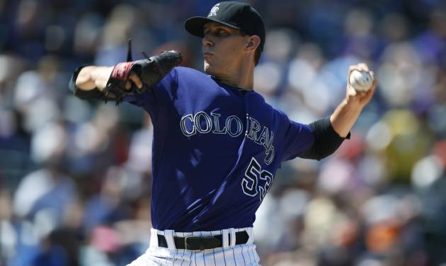 Colorado Rockies relief pitcher Chrsitian Friedrich works against the San Francisco Giants in the seventh inning of the Giants' 4-2 victory in a baseball game in Denver on Monday, Sept. 1, 2014. The game was resumed in the bottom of the sixth inning of play when it was suspended because of rain on May 22. (AP Photo/David Zalubowski)