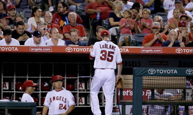 Los Angeles Angels starting pitcher Wade LeBlanc leaves the baseball game against the Miami Marlins during the fourth inning in Anaheim, Calif., Monday, Aug. 25, 2014. (AP Photo/Chris Carlson)