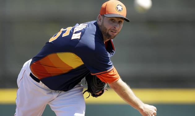 Houston Astros starting pitcher Scott Feldman warms up before a spring exhibition baseball game against the Washington Nationals in Kissimmee, Fla., Sunday, March 16, 2014. (AP Photo/Carlos Osorio)