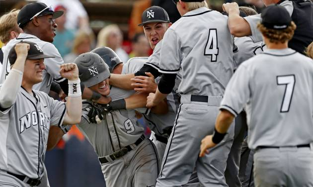 Norman North's Dylan Sterling celebrates with teammates after scoring game-winning run against Yukon during a Class 6A state baseball tournament game in Shawnee, Okla., Friday, May 10, 2013. Photo by Bryan Terry, The Oklahoman