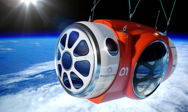 This artist rendering provided by World View Enterprises shows the World View Voyager pressurized space capsule that will be transported to the edge of space. The Arizona company says it has successfully completed the first scale test flight of a high-altitude balloon and capsule being developed to take tourists to the edge of space. World View Enterprises of Tucson said Tuesday June 24, 2014 that it launched the flight last week from Roswell, N.M. CEO Jane Poynter says the system broke the world record for highest parafoil flight, lifting a payload one-tenth of what is planned for passenger flight to 120,000 feet. (AP Photo/World View Enterprises)