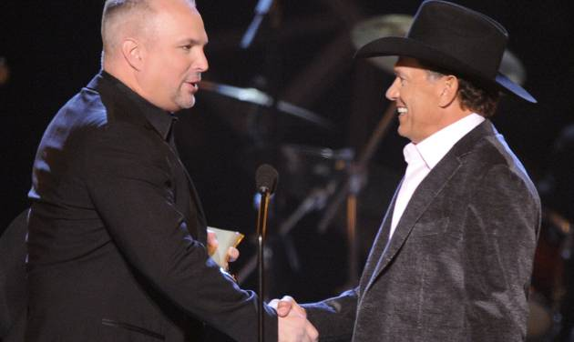 FILE - This April 6, 2009 file photo shows musician Garth Brooks, left, presenting George Strait with the Artist of the Decade award at the ACM Artist of the Decade All Star Concert in Las Vegas. Brooks and Strait will perform together for a tribute to the late Dick Clark at the 48th Annual Academy of Country Music Awards on April 7, 2013 in Las Vegas. (AP Photo/Mark J. Terrill)