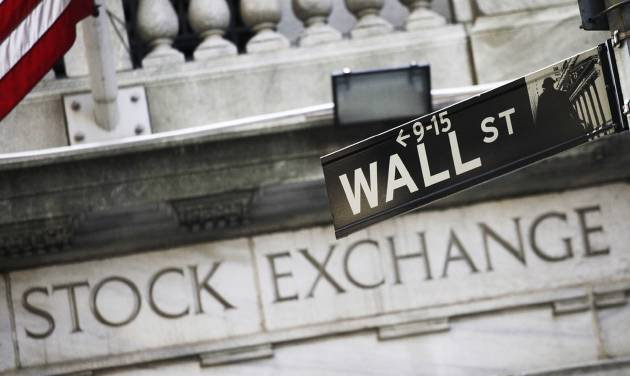 FILE - This July 16, 2013 file photo shows a street sign for Wall Street outside the New York Stock Exchange in New York. World stocks were muted as investors awaited an update on the U.S. economy later Wednesday June 18, 2014 from the Federal Reserve following its two-day policy meeting, while Japanese markets rose on a weaker yen.   (AP Photo/Mark Lennihan, File)
